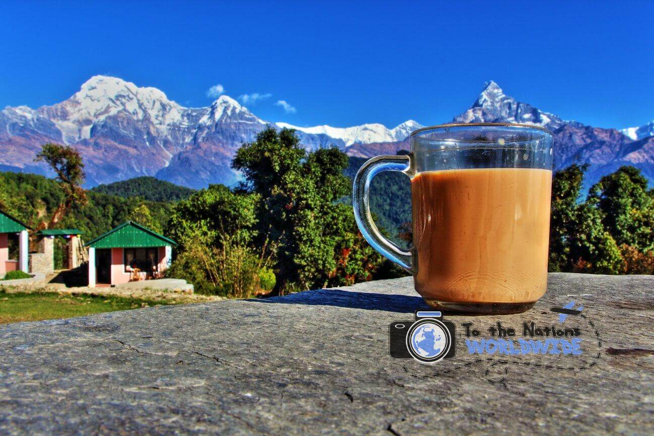 Traveling and having Nepalese tea while looking at the Annapurna mountain range.
